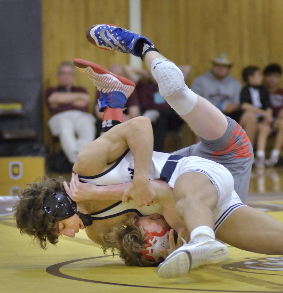 Triston Curtis of Shadow Ridge High School, left, and James Wilson from Arbor View High School compete in the Mountain Region wrestling tournament at Bonanza High School at 6665 Del Rey Ave. in La ...