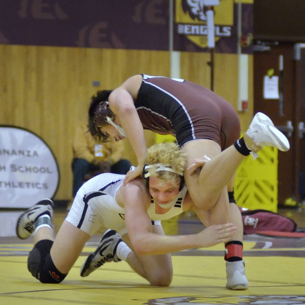 Daniel Rodriguez of Cimarron-Memorial High School, top, and Carson Cook from Faith Lutheran High School compete in the Mountain Region wrestling tournament at Bonanza High School at 6665 Del Rey A ...
