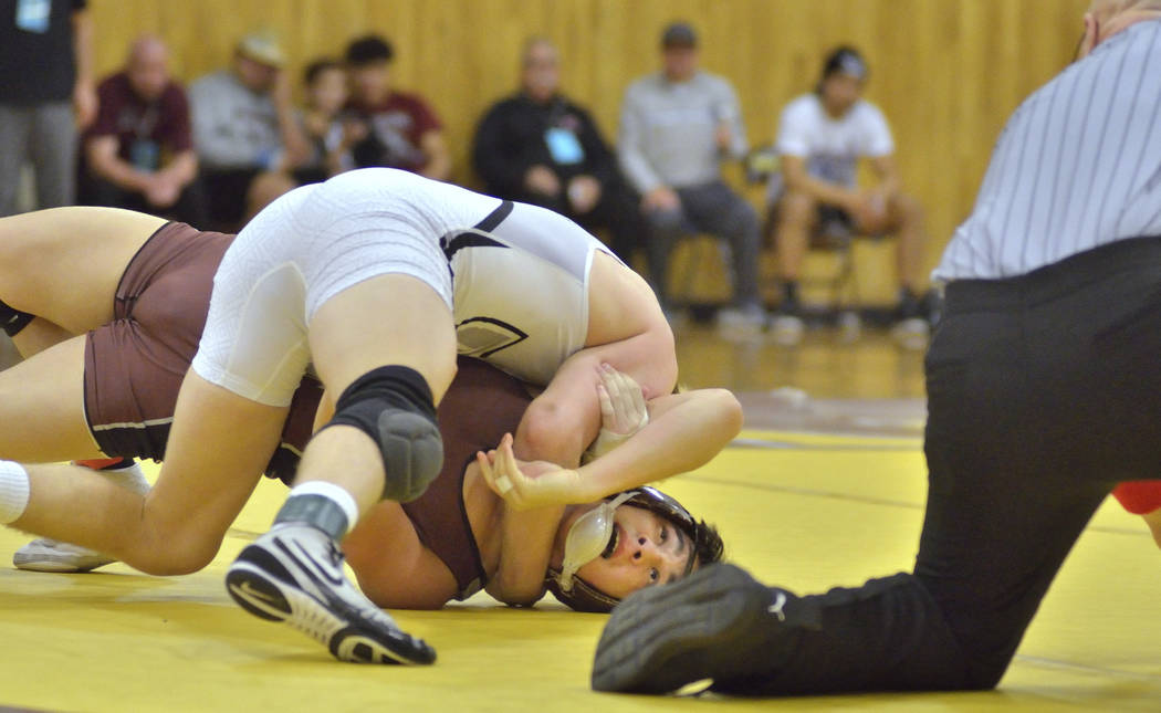 Daniel Rodriguez of Cimarron-Memorial High School, bottom, and Carson Cook from Faith Lutheran High School compete in the Mountain Region wrestling tournament at Bonanza High School at 6665 Del Re ...