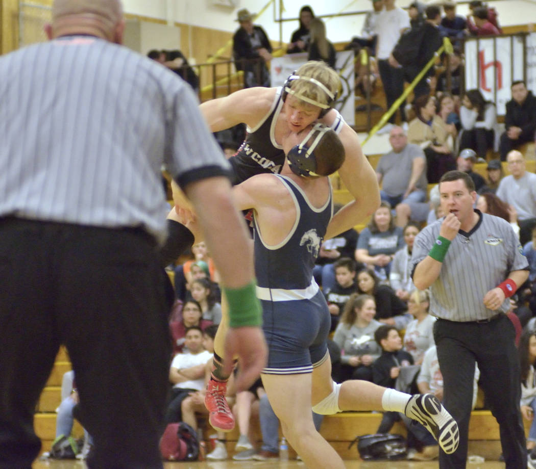 Caleb Roach of Cimarron-Memorial High School, top, and Kody Presser from Shadow Ridge High School compete in the Mountain Region wrestling tournament at Bonanza High School at 6665 Del Rey Ave. in ...