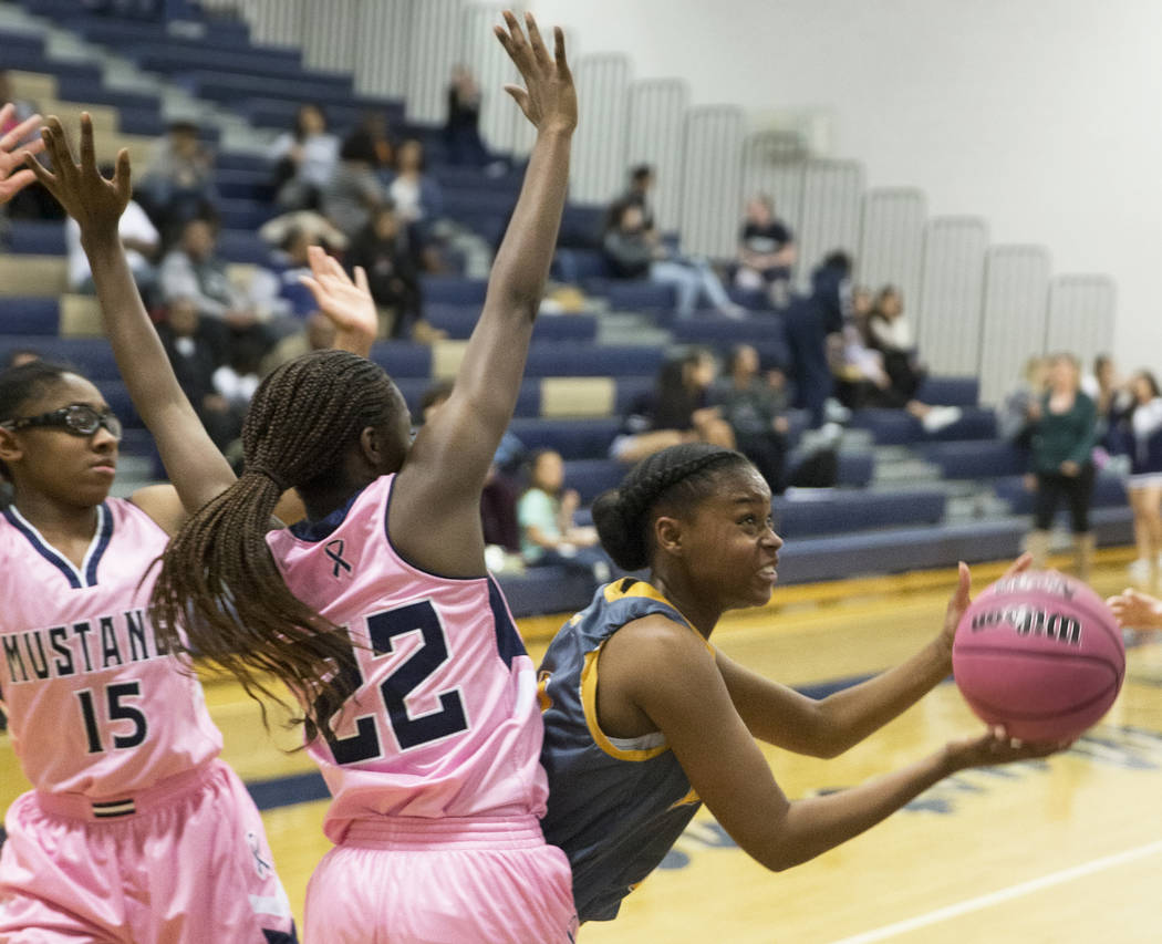 Bonanza senior Rayanna LeFear (21) slices to the rim past Shadow Ridge senior Vashay Young (22) in the second quarter on Monday, Feb. 4, 2019, at Shadow Ridge High School, in Las Vegas. (Benjamin ...