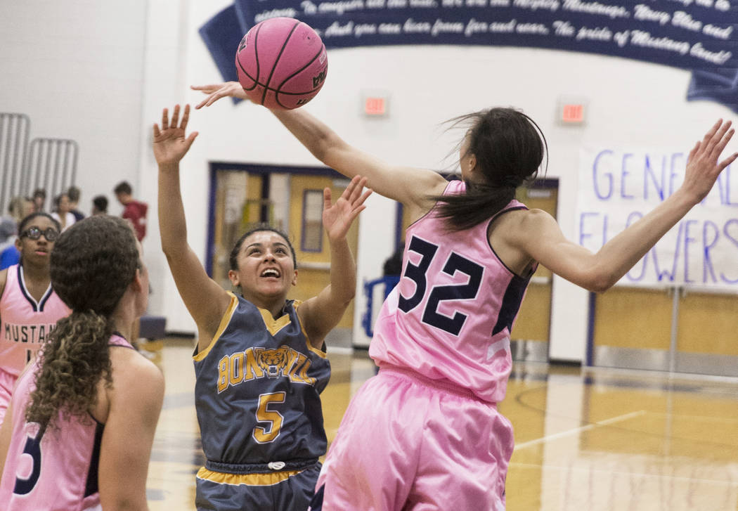 Bonanza sophomore Isaira Diaz (5) fights for a rebound with Shadow Ridge junior Christina Thames (32) and senior Caitlyn Covington (3) in the second quarter on Monday, Feb. 4, 2019, at Shadow Ridg ...