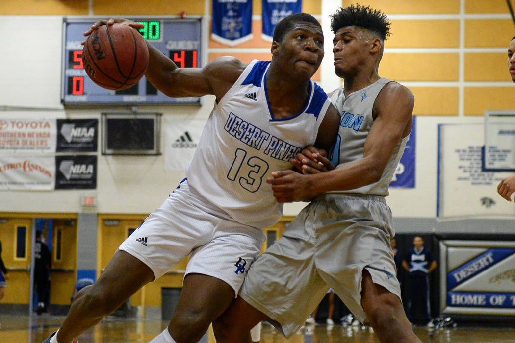 Desert Pines' Darnell Washington (13) drives past Canyon Springs' Christoper Ward (10) during a basketball game at Desert Pines High School in Las Vegas, Tuesday, Feb. 5, 2019. Caroline Brehman/La ...