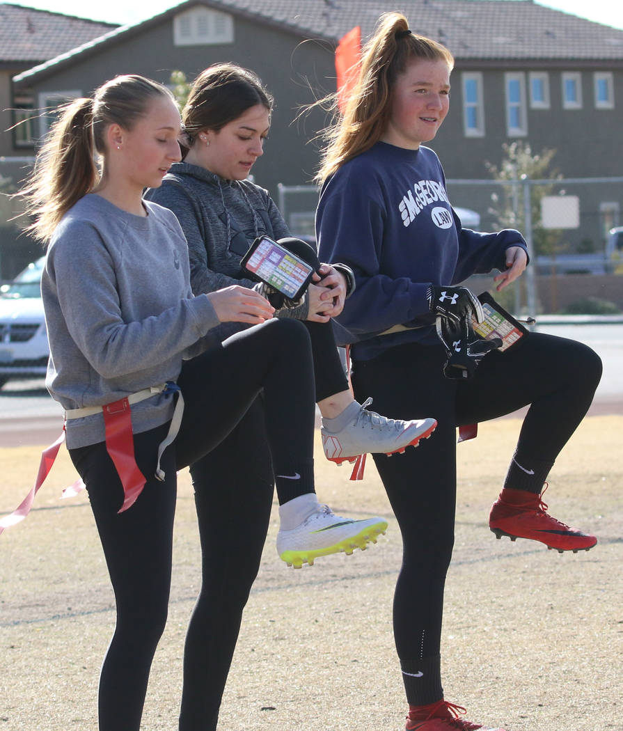 Coronado flag football quarterbacks Ashtyn Almeido, left, and Kaylin Hall, center, stretch during team practice on Wednesday, Feb. 6, 2019, at Coronado High School in Henderson. (Bizuayehu Tesfaye ...