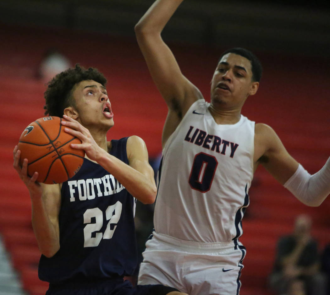Foothill's Jace Roquemore (22) drives to the net while under pressure from Liberty's Julian Strawther (0) during a basketball game at Liberty High School in Las Vegas, Wednesday, Jan. 23, 2019. Ca ...