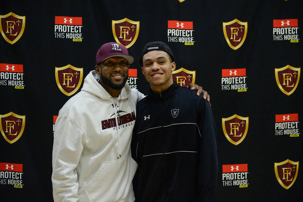 Faith Lutheran football coach Vernon Fox, left, poses with Faith Lutheran High School senior Greg Oliver after signing his national letter of intent to Portland State University in Las Vegas, Wedn ...