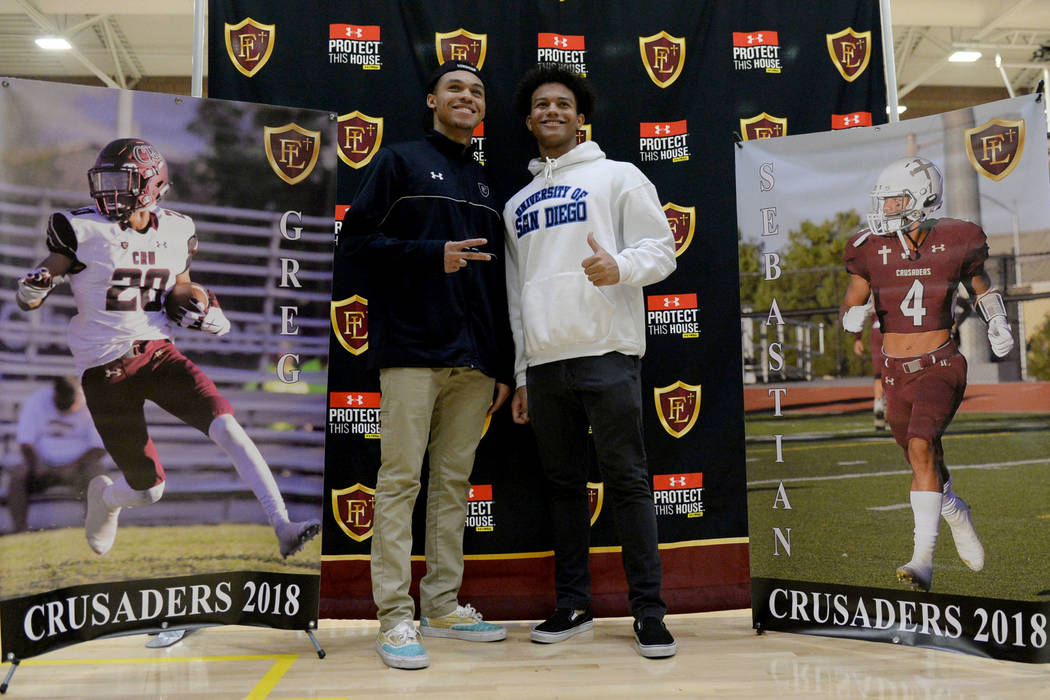Faith Lutheran High School seniors Greg Oliver, left, and Sebastian Burke pose after signing their national letters of intent at Faith Lutheran High School in Las Vegas, Wednesday, Feb. 6, 2019. C ...