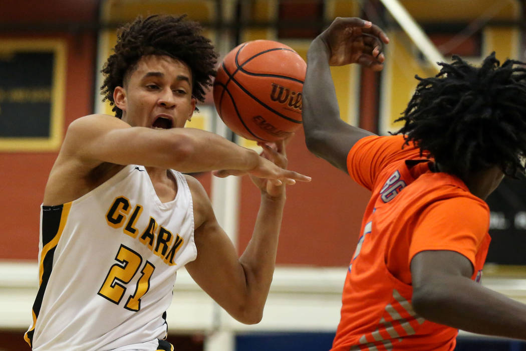 Clark's Jalen Hill (21) runs down the court with the ball during a basketball game at Clark High School in Las Vegas, Thursday, Feb. 7, 2019. Caroline Brehman/Las Vegas Review-Journal