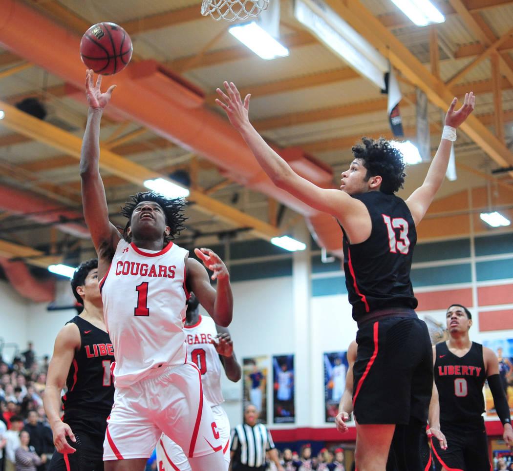 Coronado's Jaden Hardy (1) shoots the ball over Liberty's Terrance Marigney (13) in the third quarter of a game between Coronado High School and Liberty High School at Coronado High School in Hend ...