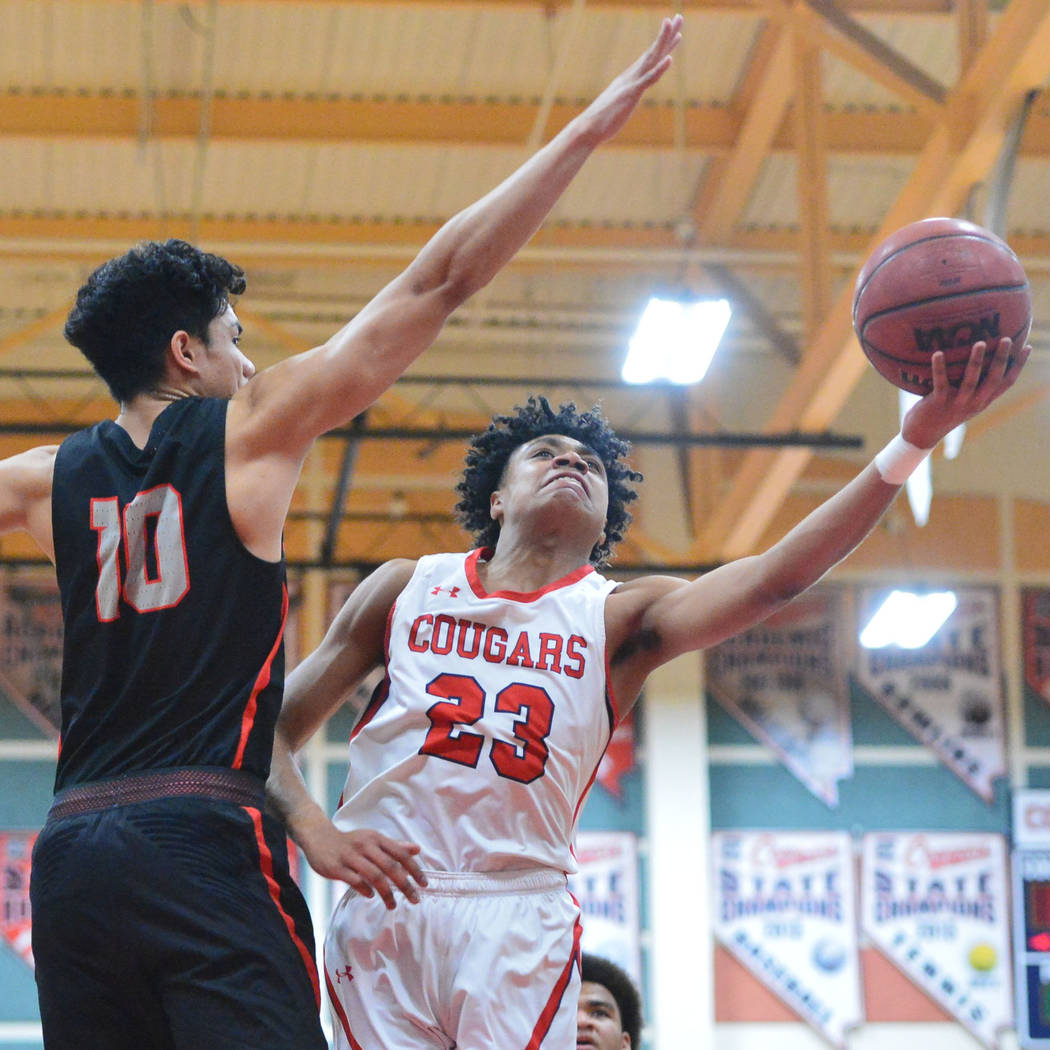Coronado's Ra'shon Martinez (23) takes a shot past Liberty's Lehi Ausage (10) in the fourth quarter of a game between Coronado High School and Liberty High School at Coronado High School in Hender ...