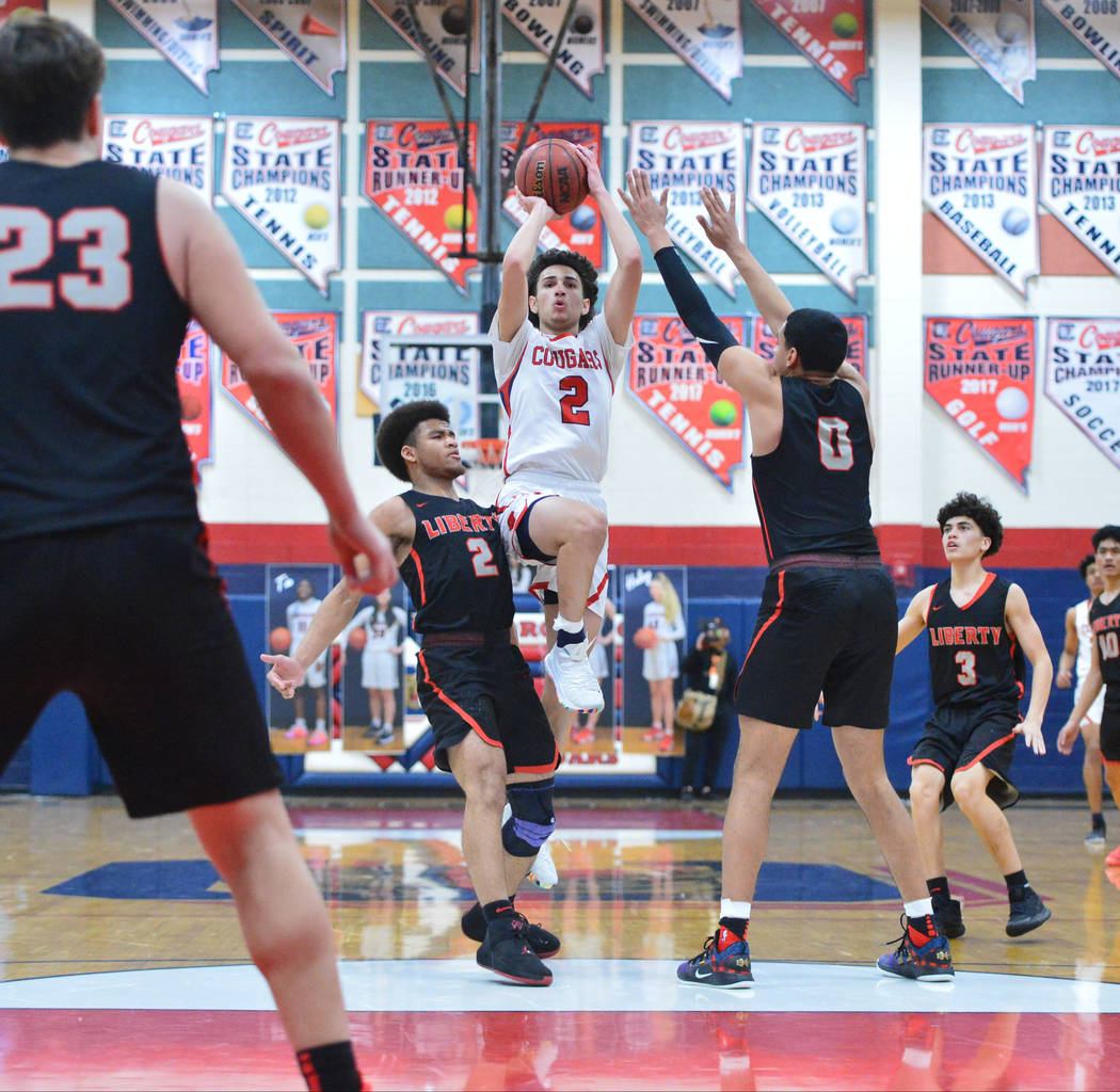 Coronado's Richard Issacs (2) takes a jump shot from the free throw line during a game between Coronado High School and Liberty High School at Coronado High School in Henderson, Nev., on Friday, F ...