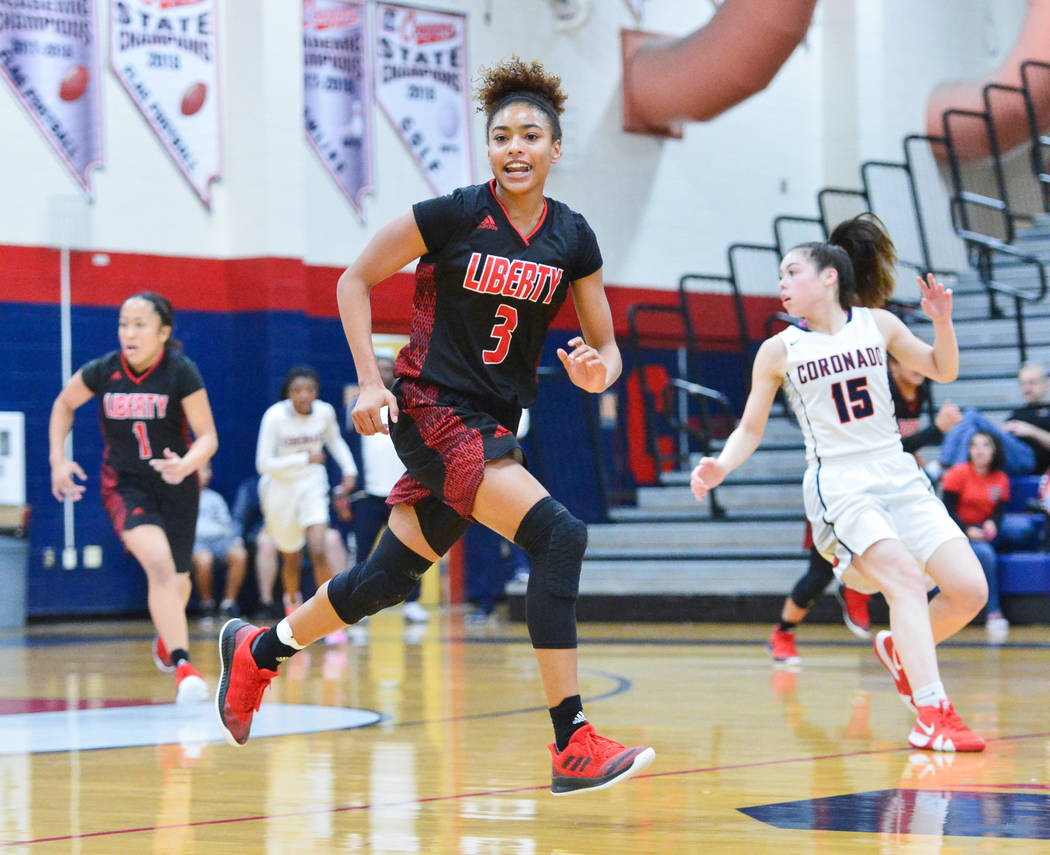 Liberty senior Journie Augmon (3) crosses half court in the second quarter of a game between Coronado High School and Liberty High School at Coronado High School in Henderson, Nev., on Friday, Feb ...