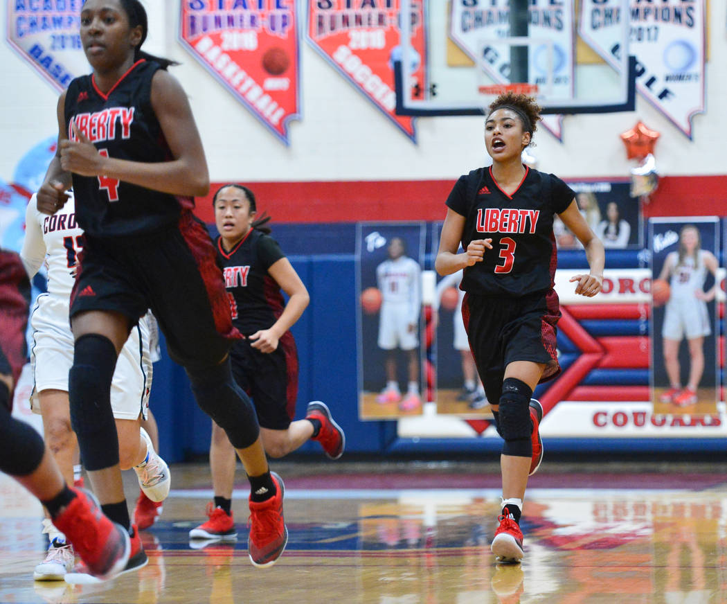 Liberty senior Journie Augmon (3) shouts to her team while they transition to defense in the second quarter of a game between Coronado High School and Liberty High School at Coronado High School i ...