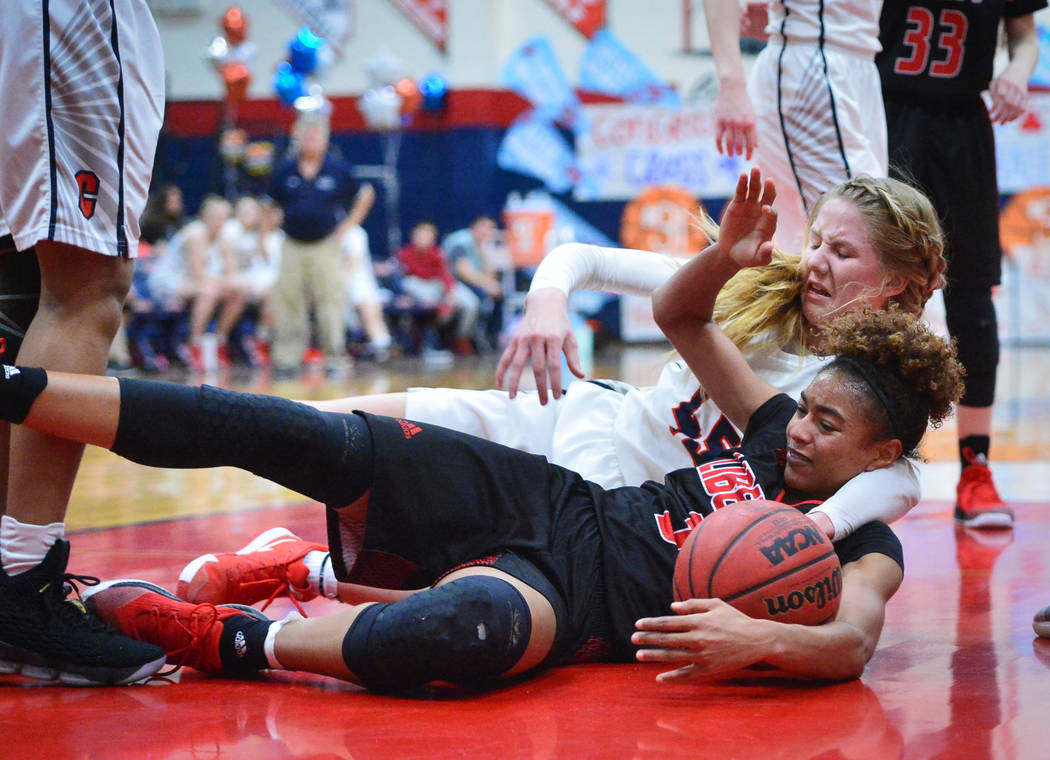Liberty senior Journie Augmon (3) fights for possession of a loose ball with Coronado senior Haley Morton (45) while waiting for a rebound in the second quarter of a game between Coronado High Sch ...