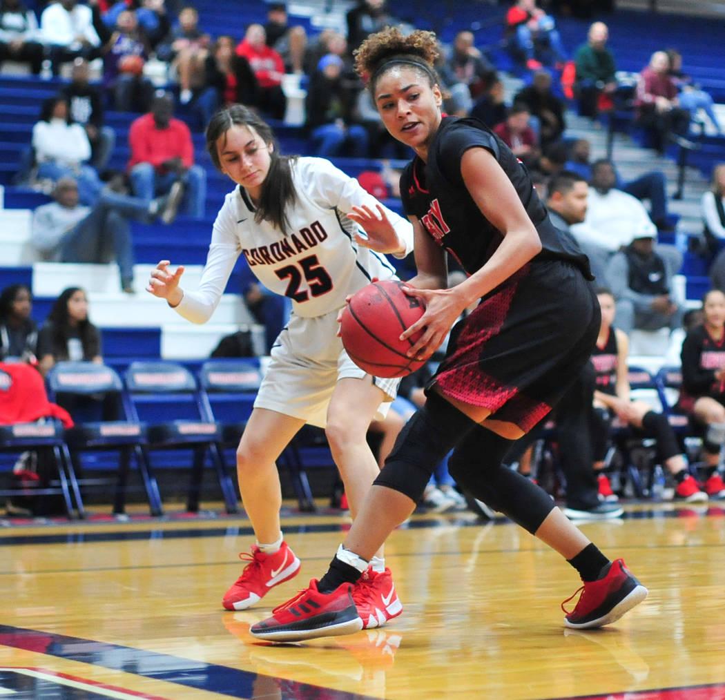 Liberty senior Journie Augmon (3) spins away from Coronado Junior Giuliana Caringella (25) in the third quarter of a game between Coronado High School and Liberty High School at Coronado High Scho ...