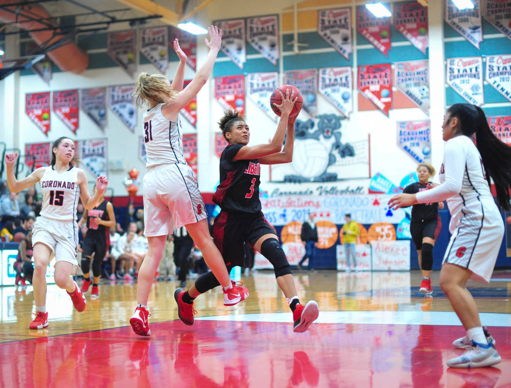 Liberty senior Journie Augmon (3) drives into the paint to take a shot during the third quarter of a game between Coronado High School and Liberty High School at Coronado High School in Henderson, ...