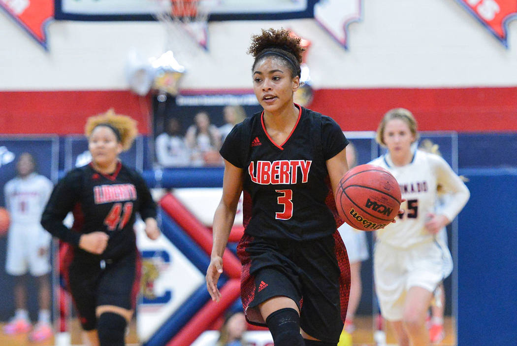 Liberty senior Journie Augmon (3) dribbles the ball across mid court in the third quarter of a game between Coronado High School and Liberty High School at Coronado High School in Henderson, Nev., ...
