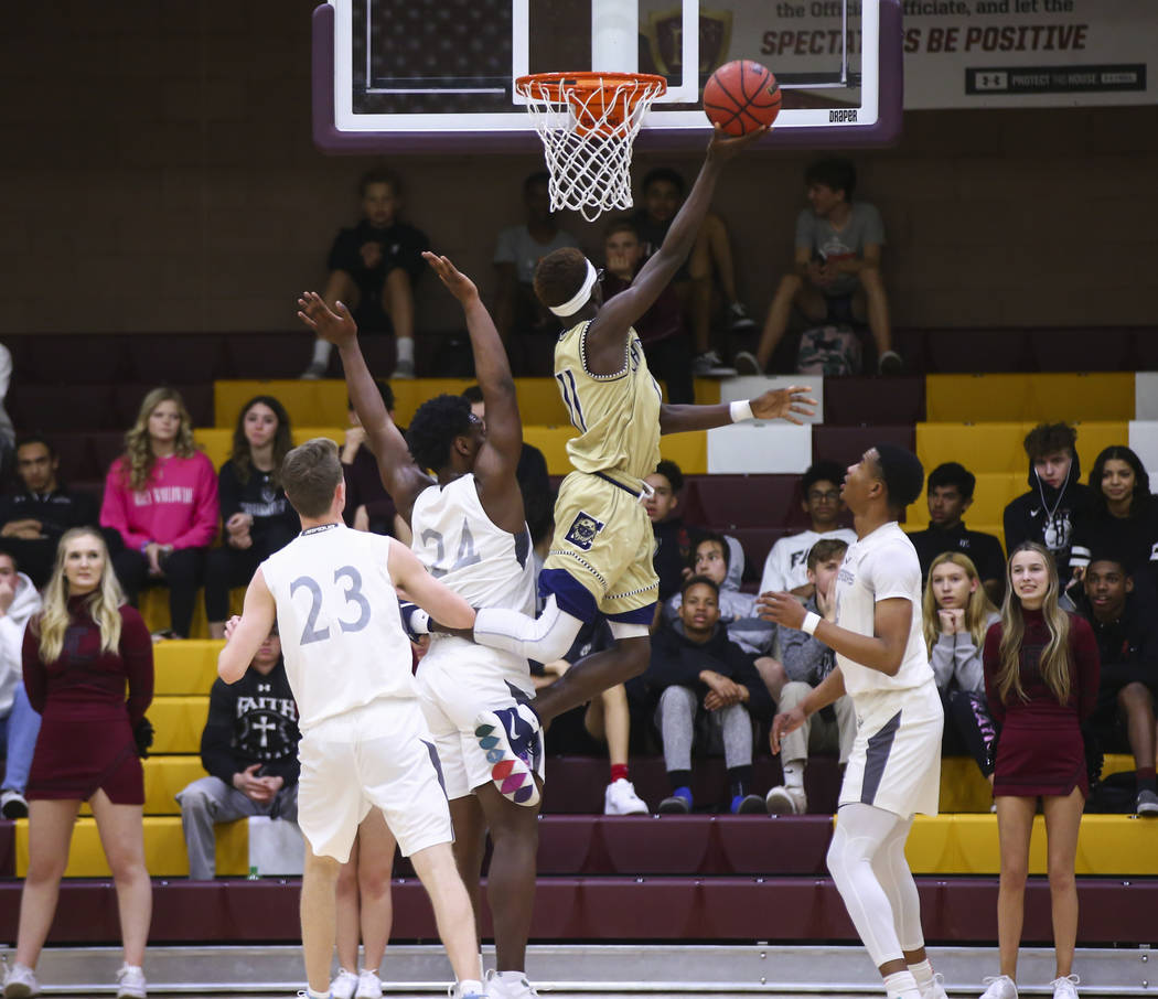 Cheyenne's Tommie Lindsey (11) goes to the basket past Faith Lutheran's D.J. Heckard (24) during the first half of a basketball game at Faith Lutheran High School in Las Vegas on Wednesday, Feb. 1 ...