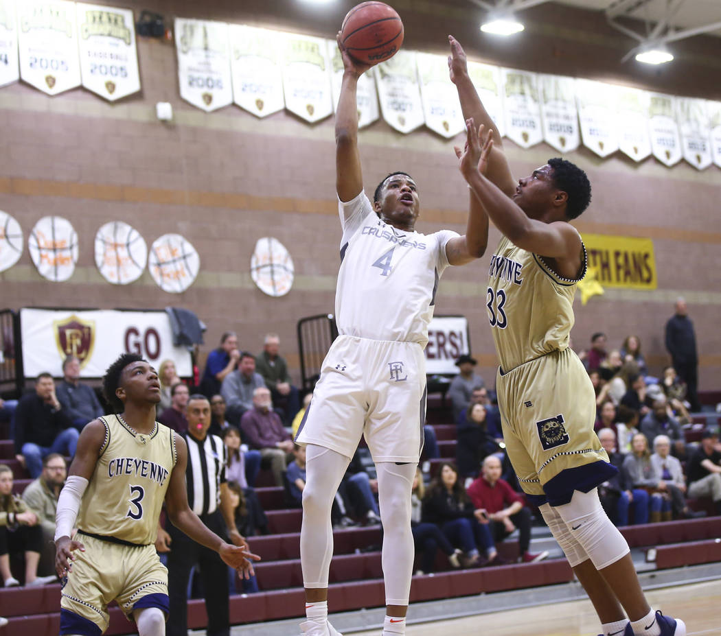 Faith Lutheran's Sedrick Hammond (4) goes to the basket against Cheyenne's Mike Reed (33) during the first half of a basketball game at Faith Lutheran High School in Las Vegas on Wednesday, Feb. 1 ...