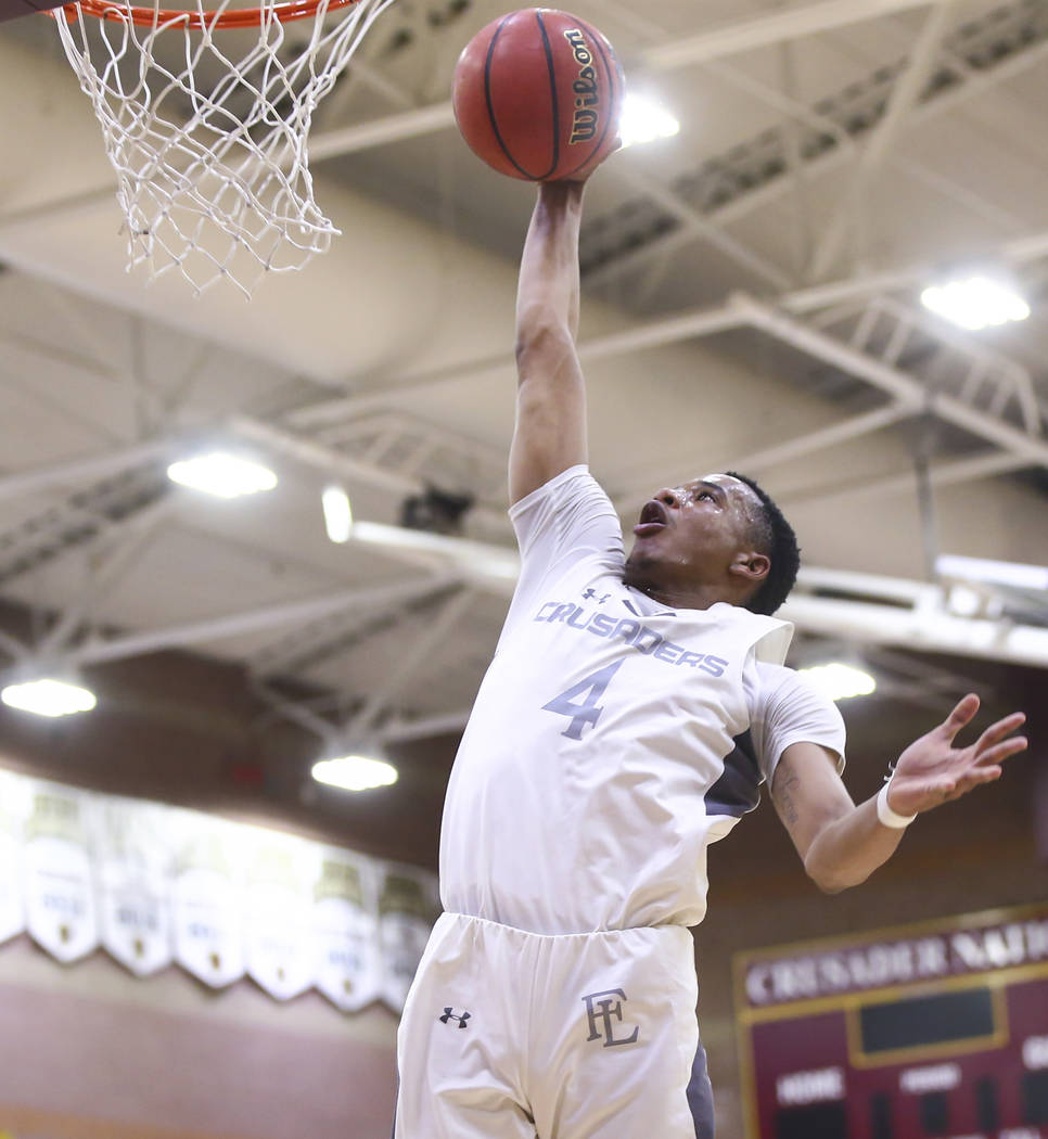 Faith Lutheran's Sedrick Hammond (4) goes to the basket against Cheyenne during the first half of a basketball game at Faith Lutheran High School in Las Vegas on Wednesday, Feb. 13, 2019. (Chase S ...