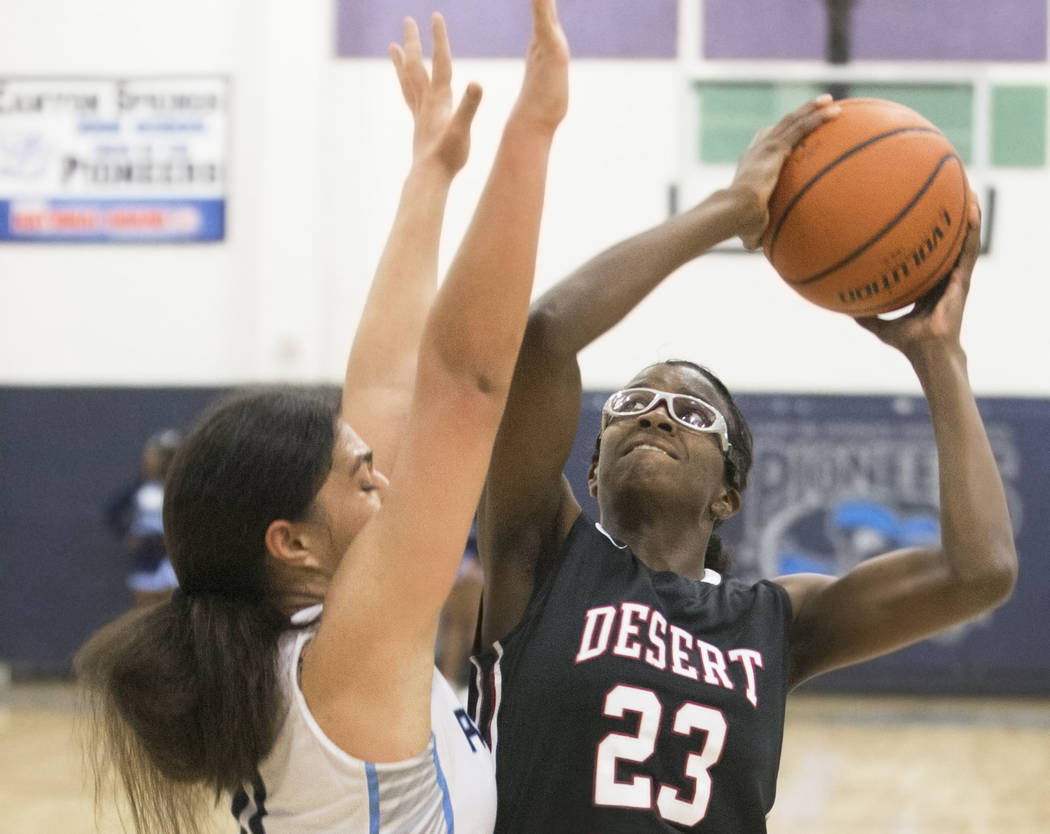 Desert Oasis junior center Desi-Rae Young (23) shoots over Canyon Springs junior forward Jeanette Fine (11) in the fourth quarter on Friday, Jan. 18, 2019, at Canyon Springs High School, in Las Ve ...