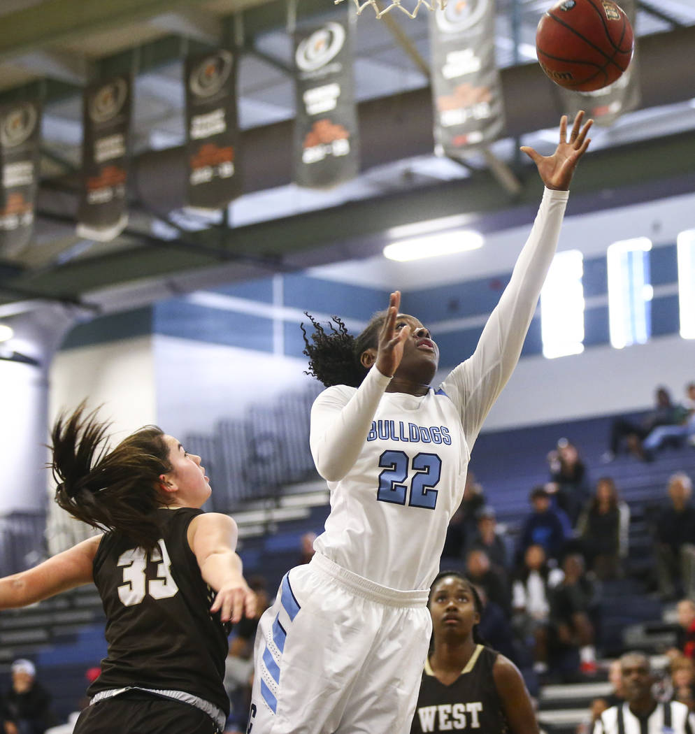 CentennialÕs Eboni Walker (22) goes to the basket past WestÕs Piper Takenaka (33) during a basketball game at Centennial High School in Las Vegas on Saturday, Dec. 29, 2018. Chase Stevens Las Ve ...
