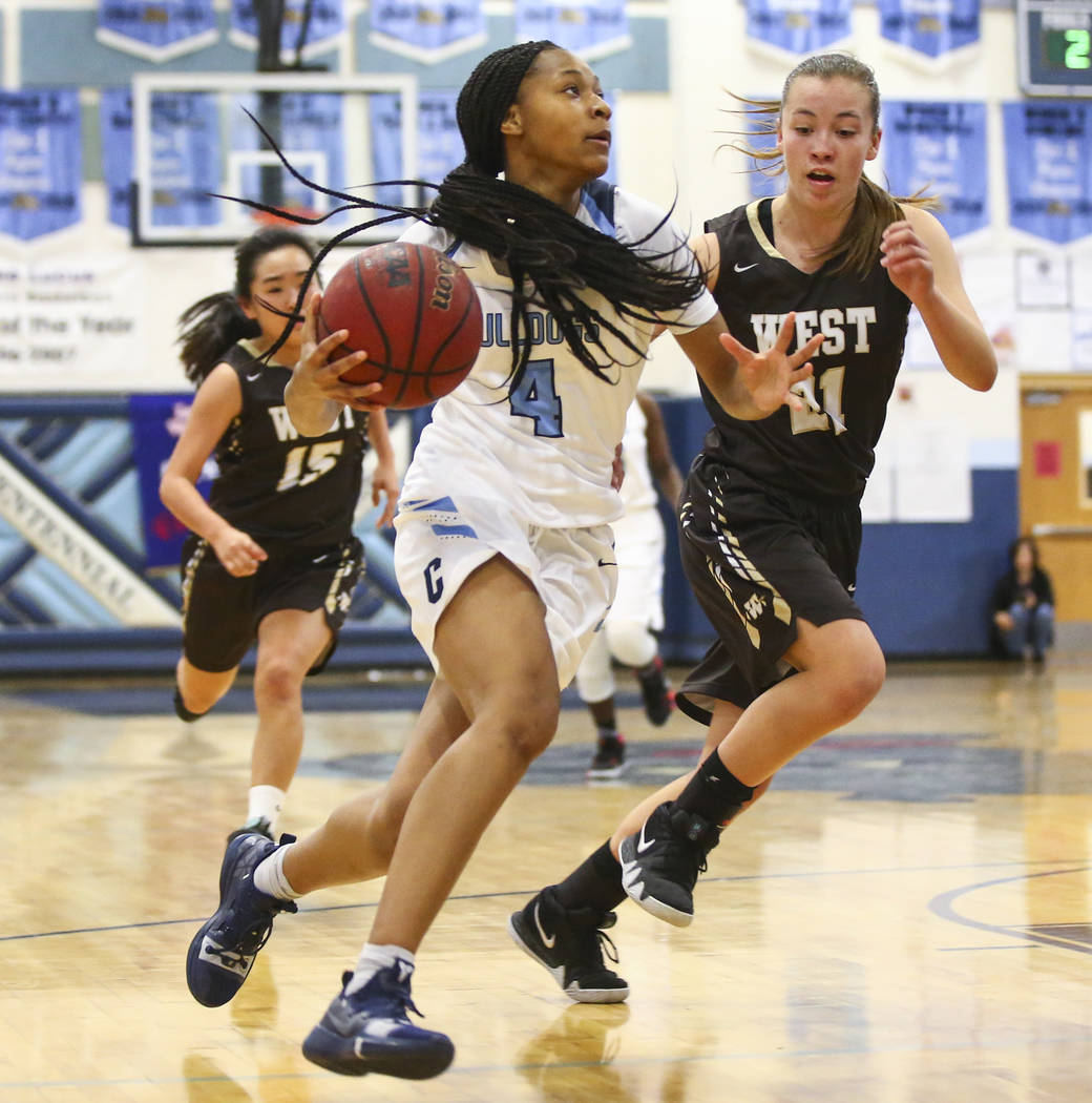 Centennial's Taylor Bigby (4) drives to the basket against WestÕs Ella Estabrook (21) during a basketball game at Centennial High School in Las Vegas on Saturday, Dec. 29, 2018. Chase Stevens Las ...