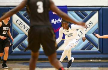 CentennialÕs Eboni Walker (22) brings the ball up court against West during a basketball game at Centennial High School in Las Vegas on Saturday, Dec. 29, 2018. Chase Stevens Las Vegas Review ...