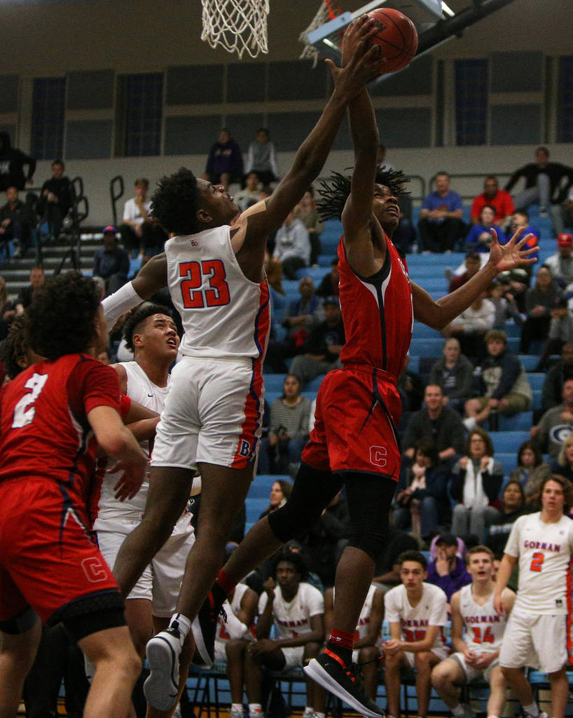 Coronado's Jaden Hardy (1) jumps up to take a shot while being guarded by Bishop Gorman's Mwani Wilkinson (23) during the Desert Region boys semifinal game at Foothill High Schoo in Henderson, Tue ...