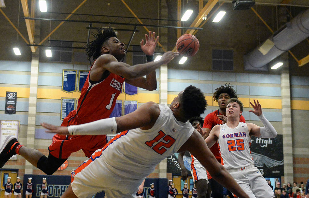 Coronado's Jaden Hardy (1) loses possession of the ball as Bishop Gorman's Max Allen (12) falls in front of him during the Desert Region boys semifinal game at Foothill High Schoo in Henderson, Tu ...