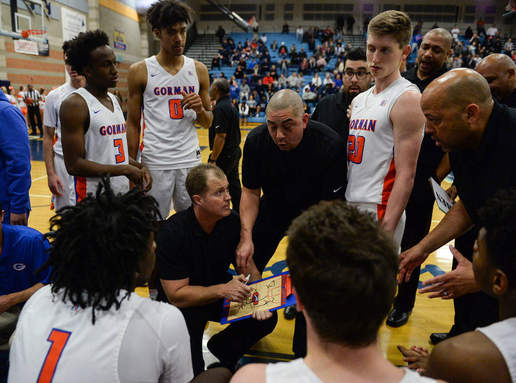 Bishop Gorman's coaches talk to the team during a timeout during a game against Coronado High School during the Desert Region boys semifinal game at Foothill High Schoo in Henderson, Tuesday, Feb. ...