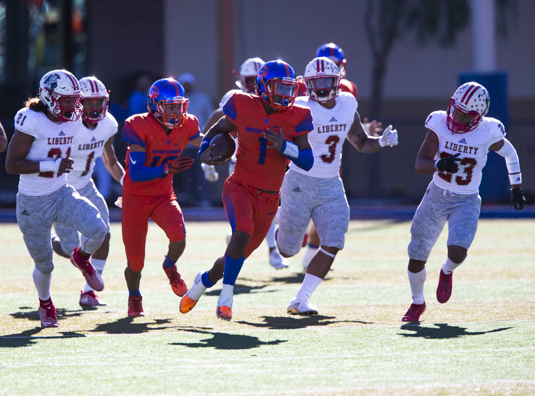 Bishop Gorman's Micah Bowens (1) breaks past Liberty defenders for a touchdown during the first half of the NIAA 4A Desert Region championship game at Bishop Gorman High School in Las Vegas on Sat ...
