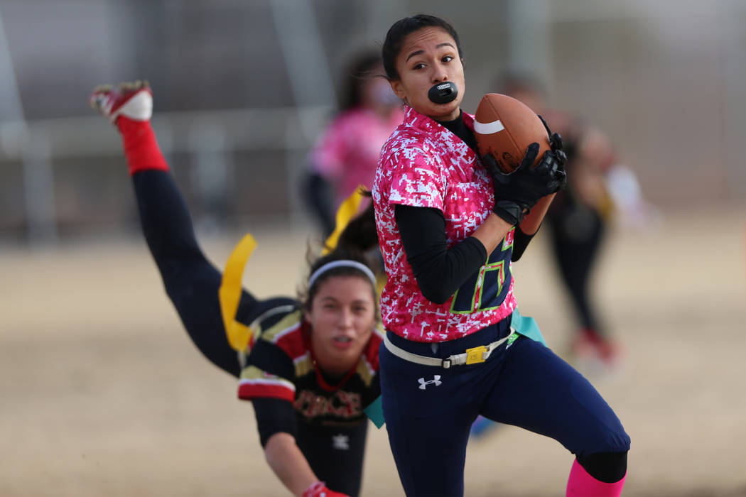 Green Valley junior Jazlyn Camacho (15) makes an interception against SECTA in the flag football game at Southeast Career Technical Academy in Las Vegas, Wednesday, Jan. 16, 2019. Erik Verduzco La ...
