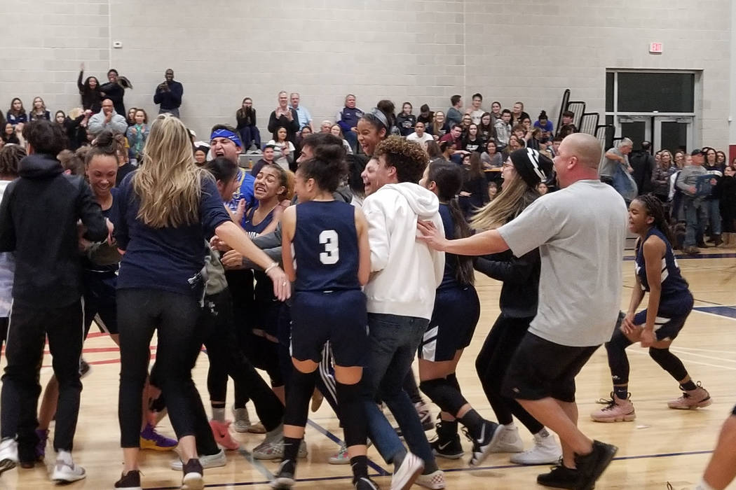 Calvary Chapel players and fans storm the court after the team's 47-43 win over Needles in the Class 2A Southern League semifinals at SLAM Academy on Friday, Feb. 22, 2019. (Damon Seiters/Las Vega ...