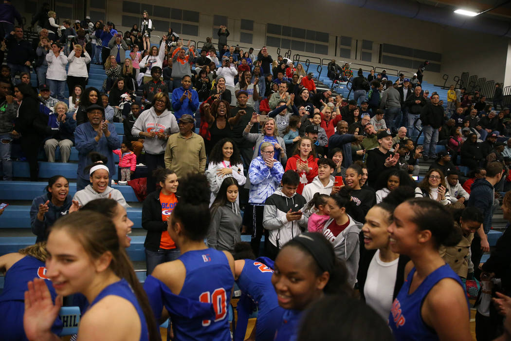 Fans celebrate with Bishop Gorman players after their win against Desert Oasis in the Desert Region girls basketball championship game at Foothill High School in Henderson, Saturday, Feb. 23, 2019 ...
