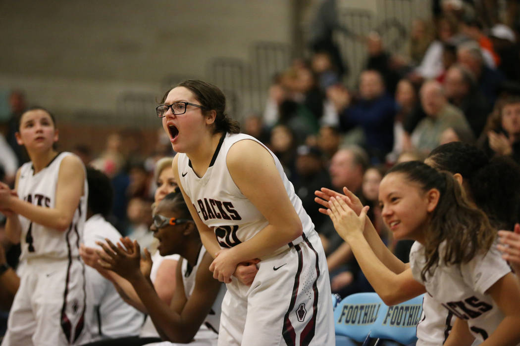 The Desert Oasis bench including Arrianna Spring (20), center, reacts after a play against Bishop Gorman in the Desert Region girls basketball championship game at Foothill High School in Henderso ...