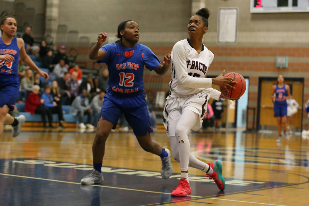 Bishop Gorman's Aaliyah Bey (12) defends against Desert Oasis' Ahmaya Smith (15) in the Desert Region girls basketball championship game at Foothill High School in Henderson, Saturday, Feb. 23, 20 ...
