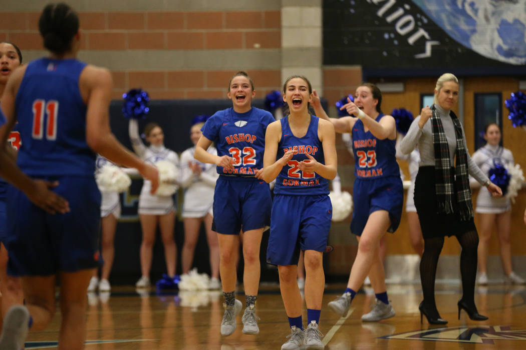 The Bishop Gorman bench reacts after a score by Olivia Smith (11) to beat the buzzer in the second quarter against Desert Oasis in the Desert Region girls basketball championship game at Foothill ...