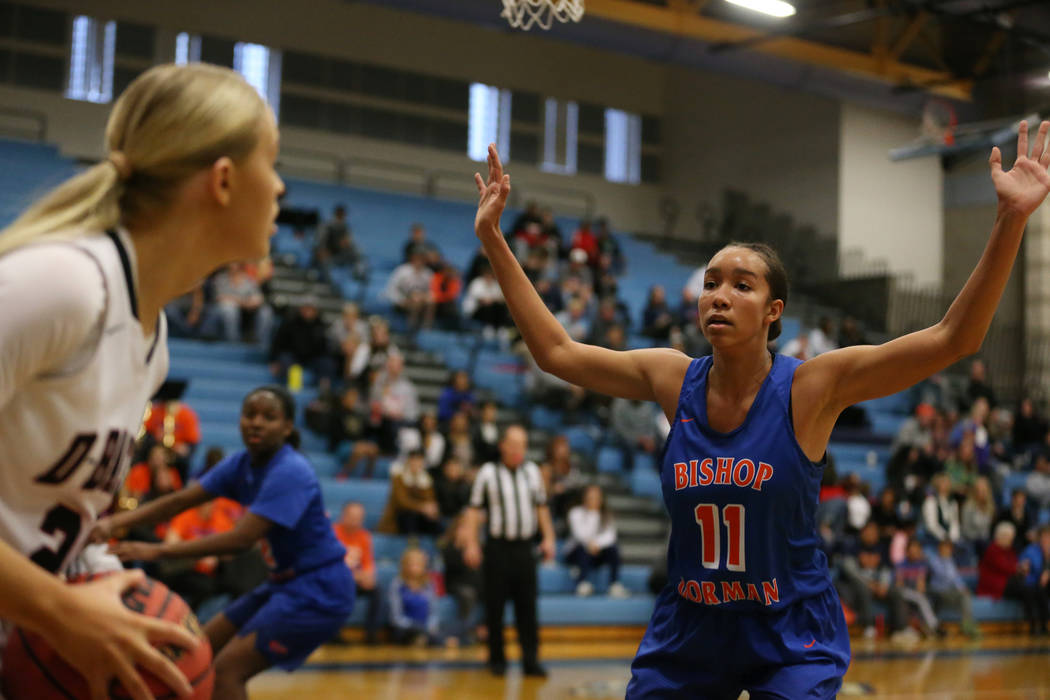 Bishop Gorman's Olivia Smith (11) defends against Desert Oasis' Melissa Simmons (25) in the Desert Region girls basketball championship game at Foothill High School in Henderson, Saturday, Feb. 23 ...