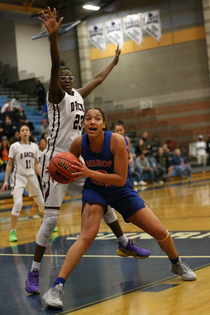 Bishop Gorman's Georgia Ohiaeri (3) looks to make a play under pressure from Desert Oasis' Desi-Rae Young (23) in the Desert Region girls basketball championship game at Foothill High School in He ...