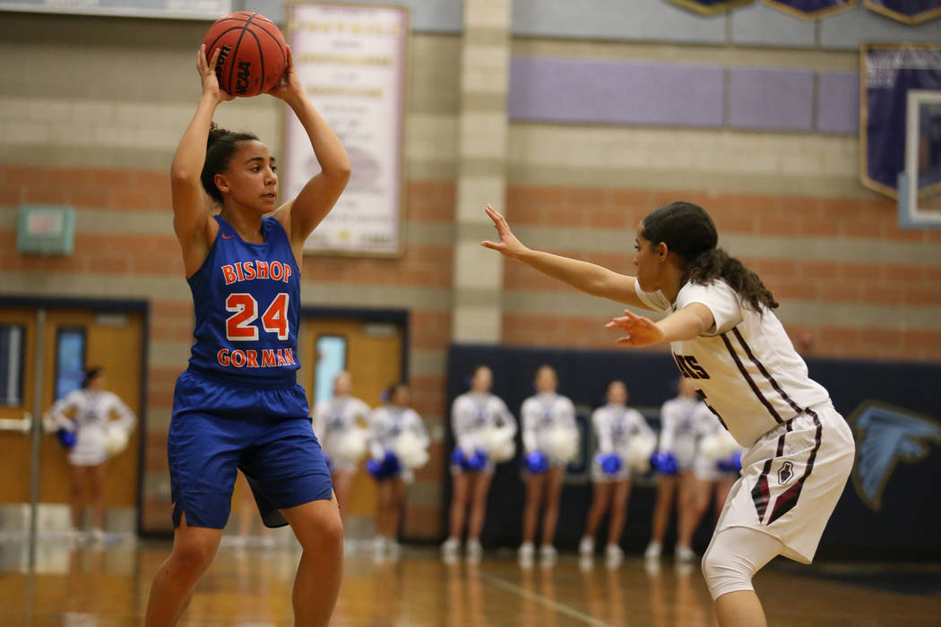 Bishop Gorman's Bentleigh Hoskins (24) looks to make a play under pressure from Desert Oasis Eliyjah Pricebrooks (5) in the Desert Region girls basketball championship game at Foothill High School ...