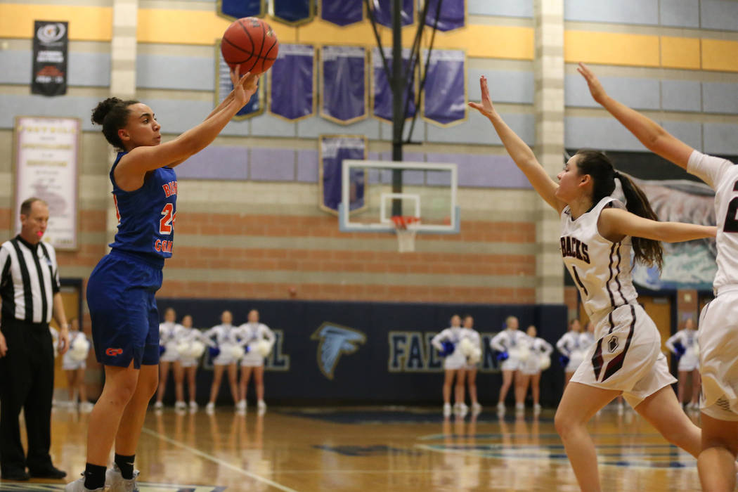 Bishop Gorman's Bentleigh Hoskins (24) shoots a three-point-shot for a score against Desert Oasis in the Desert Region girls basketball championship game at Foothill High School in Henderson, Satu ...