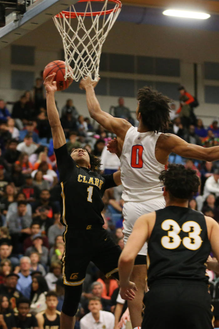 Bishop Gorman's Isaiah Cottrell (0) blocks Clark's Frankie Collins (1) in the Desert Region boys basketball championship game at Foothill High School in Henderson, Saturday, Feb. 23, 2019. Bishop ...