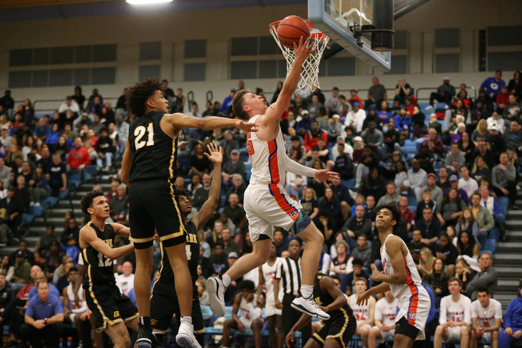 Bishop Gorman's Chance Michels (25) goes up for a shot against Clark in the Desert Region boys basketball championship game at Foothill High School in Henderson, Saturday, Feb. 23, 2019. Bishop Go ...