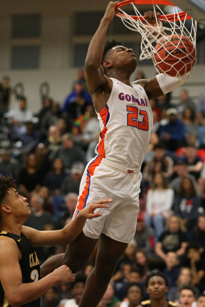 Bishop Gorman's Mwani Wilkinson (23) dunks the ball against Clark in the Desert Region boys basketball championship game at Foothill High School in Henderson, Saturday, Feb. 23, 2019. Bishop Gorma ...