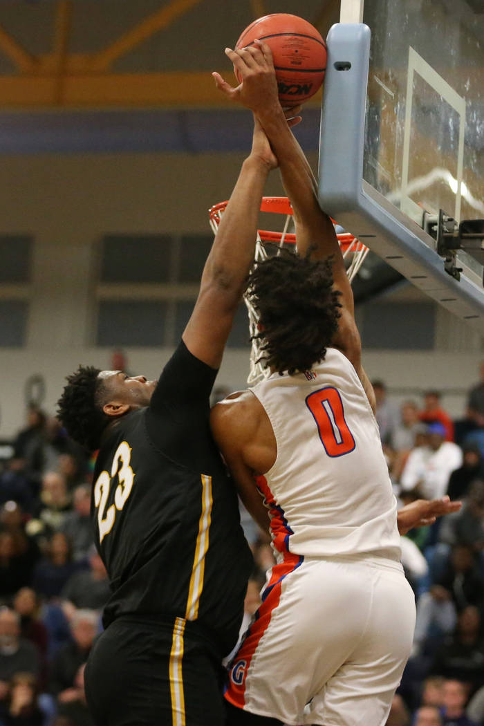 Clark's Antwon Jackson (23) makes a block against Bishop Gorman's Isaiah Cottrell (0) in the Desert Region boys basketball championship game at Foothill High School in Henderson, Saturday, Feb. 23 ...