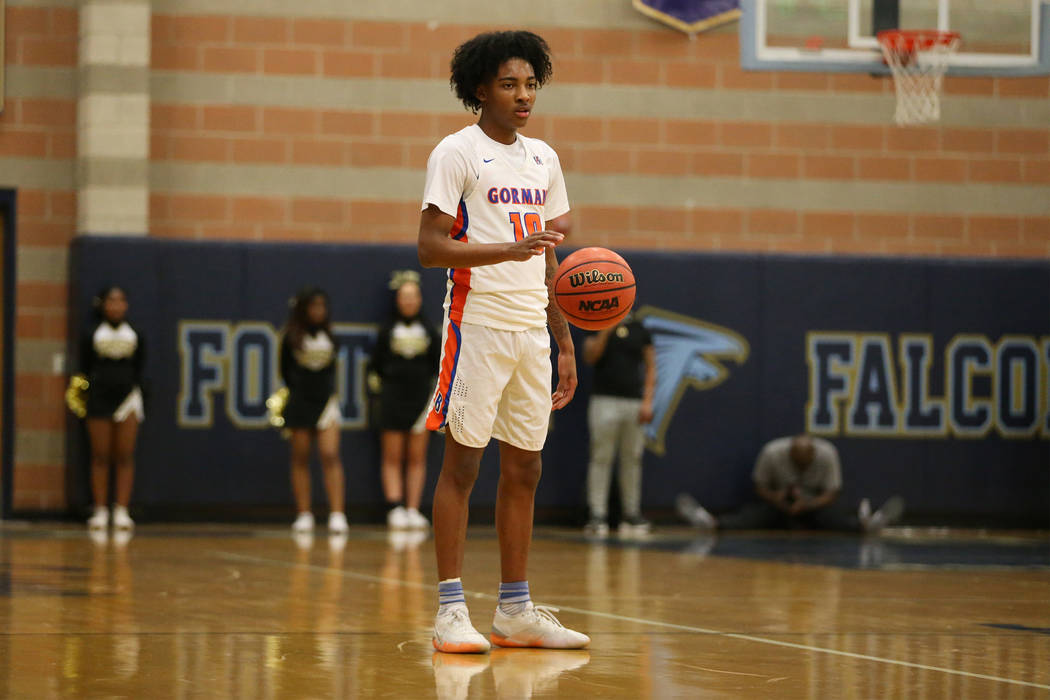 Bishop Gorman's Zaon Collins (10) lets the clock run against Clark in the Desert Region boys basketball championship game at Foothill High School in Henderson, Saturday, Feb. 23, 2019. Bishop Gorm ...