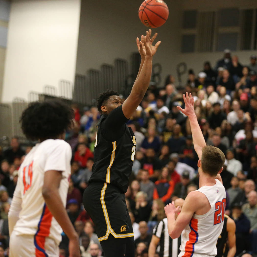 Clark's Antwon Jackson (23) takes a shot for a score against Bishop Gorman in the Desert Region boys basketball championship game at Foothill High School in Henderson, Saturday, Feb. 23, 2019. Bis ...