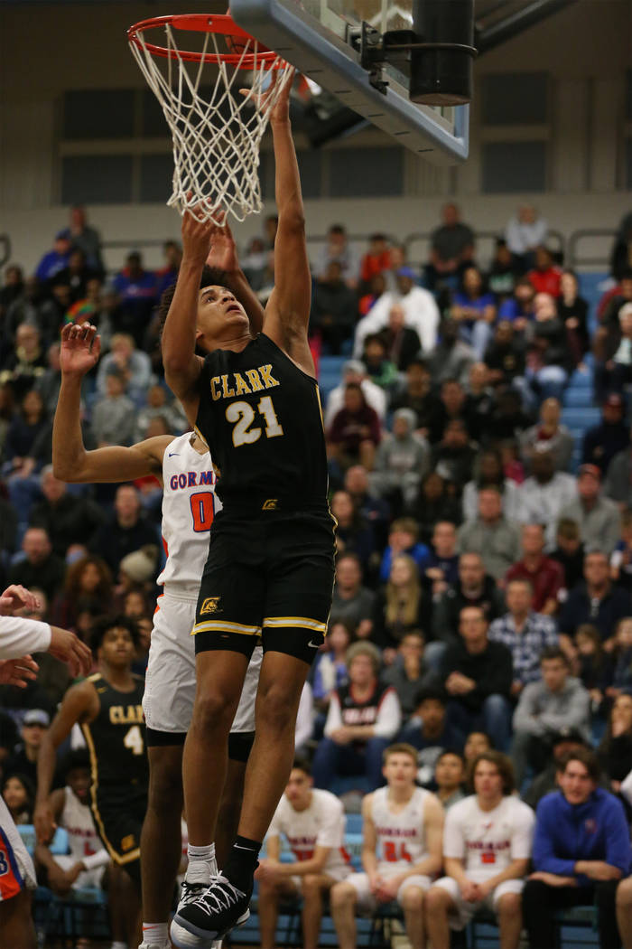 Clark's Jalen Hill (21) goes up for a shot against Bishop Gorman in the Desert Region boys basketball championship game at Foothill High School in Henderson, Saturday, Feb. 23, 2019. Bishop Gorman ...