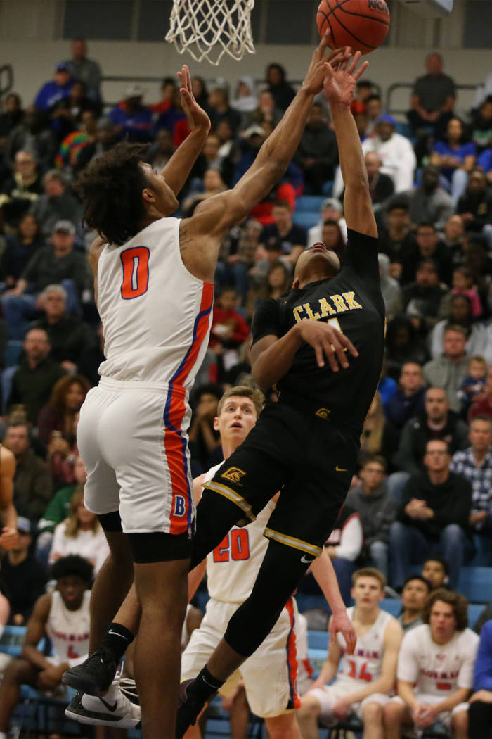 Clark's Frankie Collins(1) gets his shot blocked by Bishop Gorman's Isaiah Cottrell (0) in the Desert Region boys basketball championship game at Foothill High School in Henderson, Saturday, Feb. ...